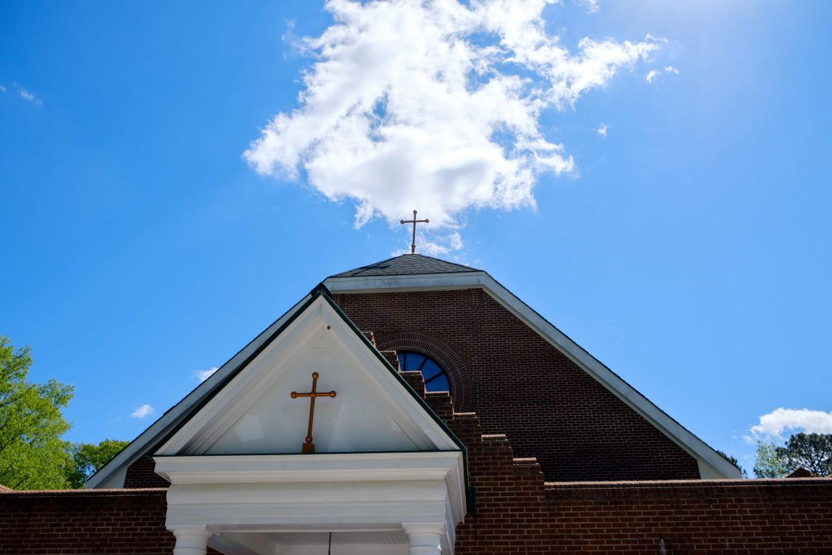 Catholic Church Exterior During a Clear Blue Sky - Catholic Stock Photo