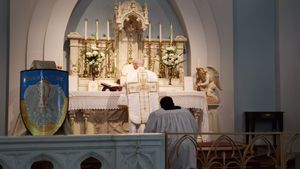 Priest Bowing at Latin Mass - Catholic Stock Photo