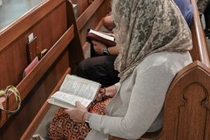 Woman Reading Missal at Latin Mass - Catholic Stock Photo