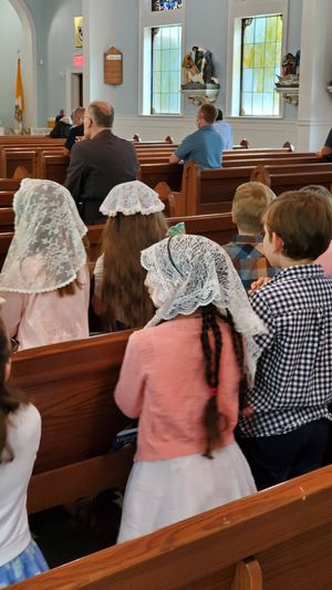 Children Praying before Mass - Catholic Stock Photo